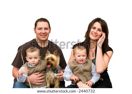 Cut out of a happy family with twin boys and pet dog