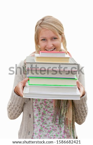 Cut Out Of Teenage Student Holding Pile Of Textbooks