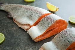 Cut rainbow trout on grey background