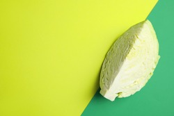 Cut ripe cabbage on color background, top view