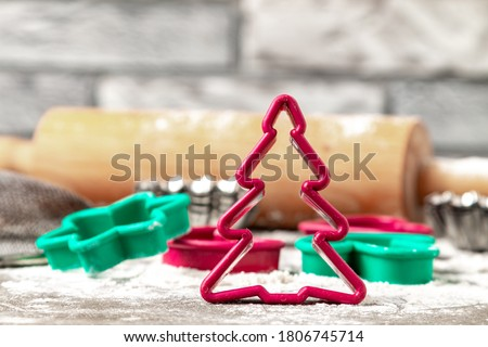 Cut shape of red Christmas tree cookies. Christmas cookies shapes on the table Photo stock ©