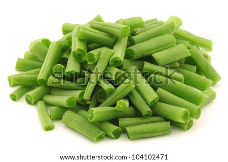 cut small and slender green beans (haricot vert) on a white background