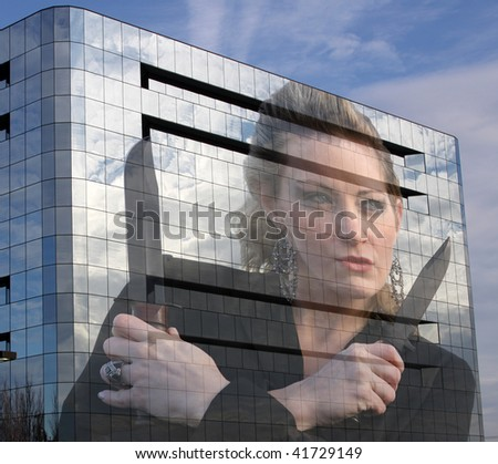 cut throat business woman with knives reflected in office building