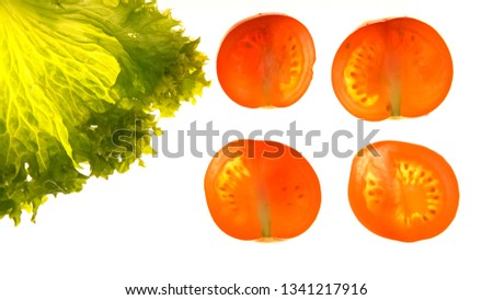 Cut tomatoes and lettuce on white background, ecological products, gmo free #1341217916