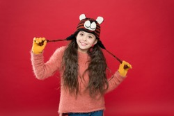 Cute accessories. Girl wear winter theme accessory. Fun and joy. Playful tiger. Festive spirit. Cheerful smiling kid. Playful cutie. Children seems cute. Adorable baby wear cute winter knitted hat.