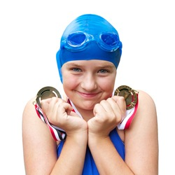 Cute adolescent girl in cobalt blue swimwear smiles proudly and holds two swimming medals close to her face. Square format, isolated on white background, copy space.