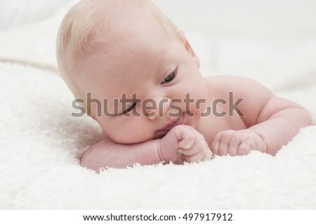 Cute adorable newborn blonde baby portrait