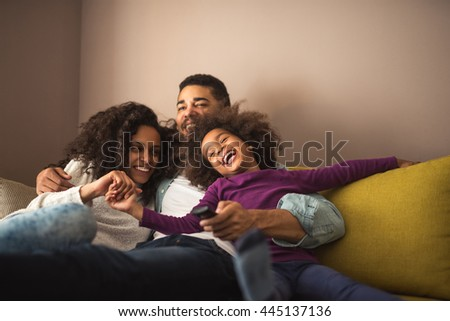 Cute african american family enjoying time together.