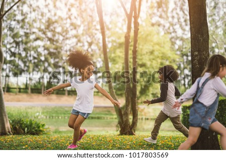 Cute african american little girl playing outdoor - Black people kid and friend happy. #1017803569