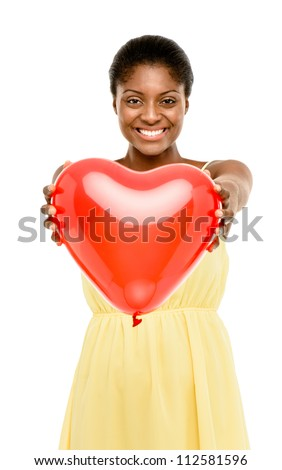 Cute african american woman holding red balloon heart isolated on white background