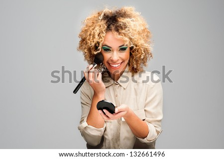 Cute Afro Woman Making Up