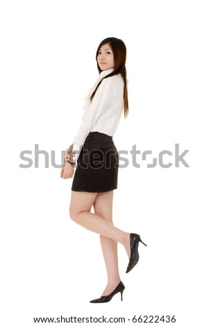 Cute and beautiful business woman, full length portrait isolated over white.