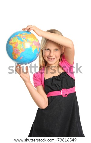Cute and confident young preteen girl holding the world globe in her fingers