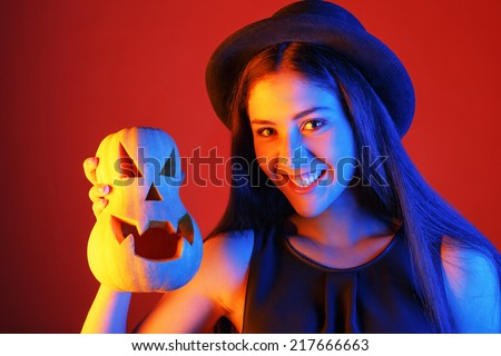 cute and funny witch with pumpkin. holiday Halloween