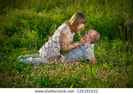 Cute and happy couple spending a romantic time together on nature