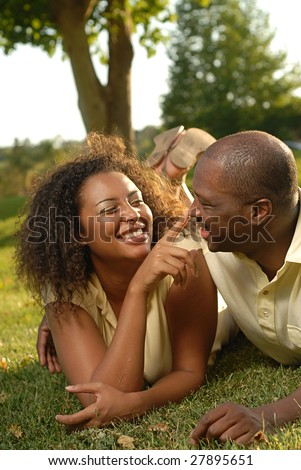 stock photo : Cute and loving couple playing around on the lawn