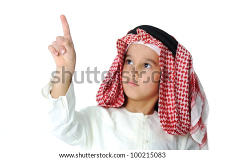 Cute Arabic kid pressing digital button, excellent place for your message