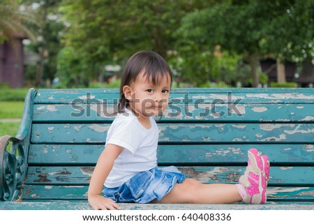 cute asia little girl sitting...