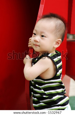 Men stock photo : Cute Asian baby with a mohawk hairstyle