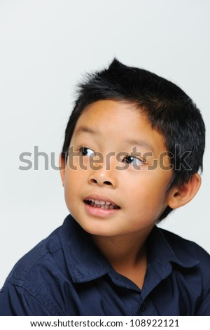 Cute asian boy looking away and smiling
