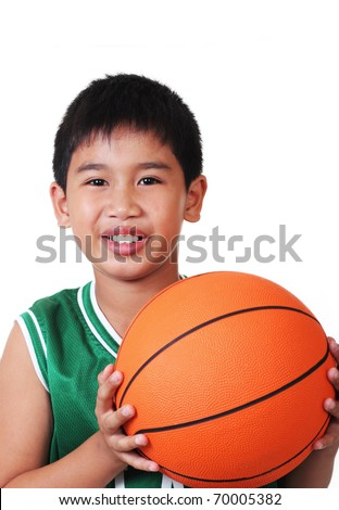 cute asian boy playing basketball in white background