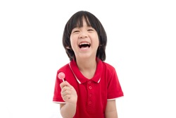 Cute Asian child eating a lollipop on white background isolated