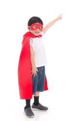 Cute Asian child  in Superhero's costume pointing on white background isolated