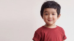 Cute Asian child little Thai boy 2 year old smile make a happy face concept.