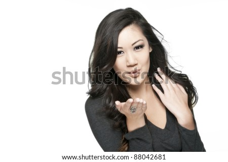 cute asian girl blowing a kiss, white background