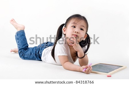 cute asian girl drawing on the chalkboard
