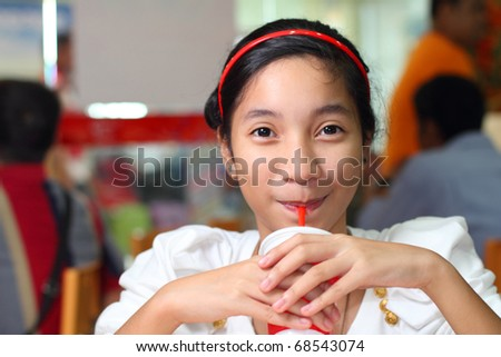 cute asian girl drinking a soda