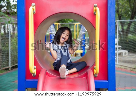 cute asian girl happy play in play park outdoor park in summer #1199975929