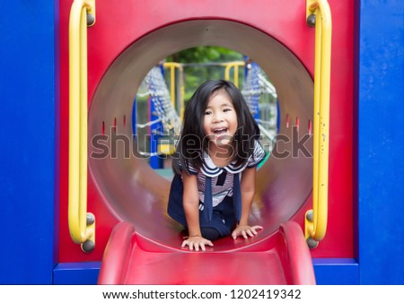cute asian girl happy play in play park outdoor park in summer #1202419342