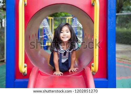 cute asian girl happy play in play park outdoor park in summer #1202851270