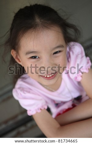 cute asian girl with smiling face in town background