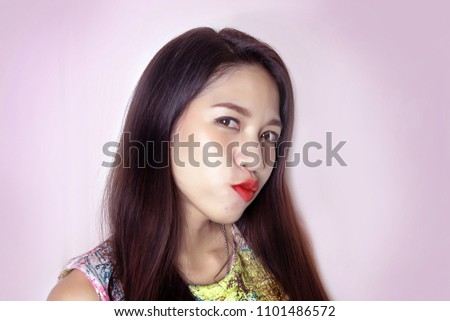 cute asian lady smile with red lipstick on studio shot. Confidence lady with cosmetic on face.Sexy asian lady portrait on white background.