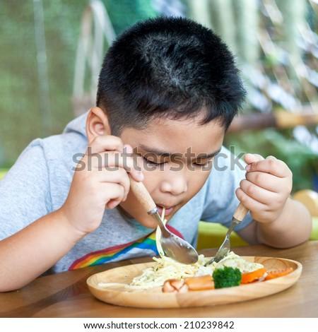 cute asian little boy enjoying...