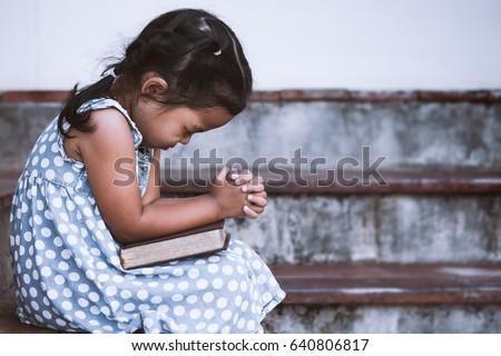 cute asian little girl closed...