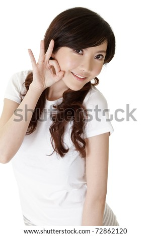 Cute Asian woman give you an OK gesture on white background.