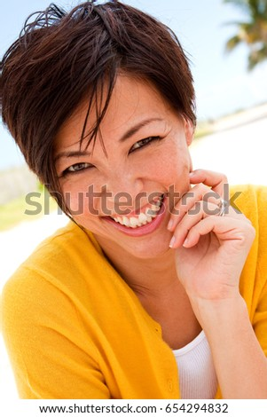 cute asian woman smiling at the ...