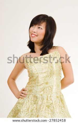 Cute asian women in gold evening dress with attractive look