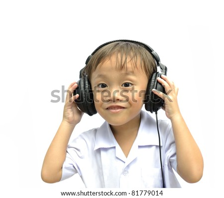 cute asian young boy using headphone on white background.