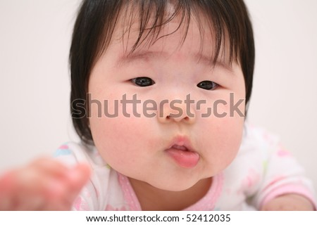 Cute Baby Asian Infant Girl Shifting Lip to Left