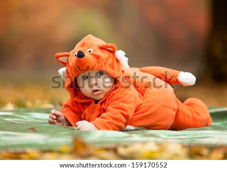 Stock Photo Cute baby boy dressed in fox costume in autumn park