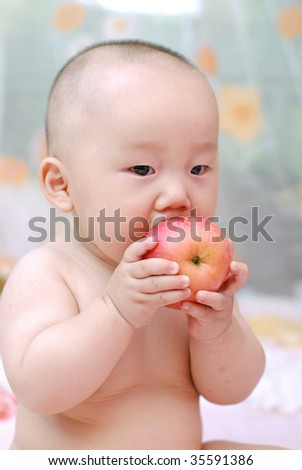 stock-photo-cute-baby-boy-eat-red-apple-