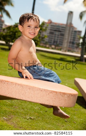 Cute baby boy having fun outdoors in a park setting.