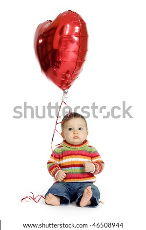 Cute baby boy holding a heart-shaped balloon