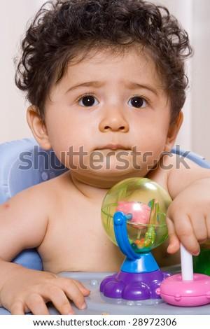cute baby boy in baby walker