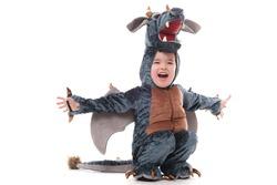 Cute baby boy in dragon costume.