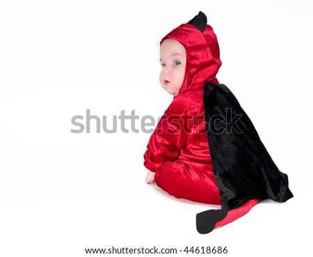 Cute baby boy in halloween outfit on isolated background